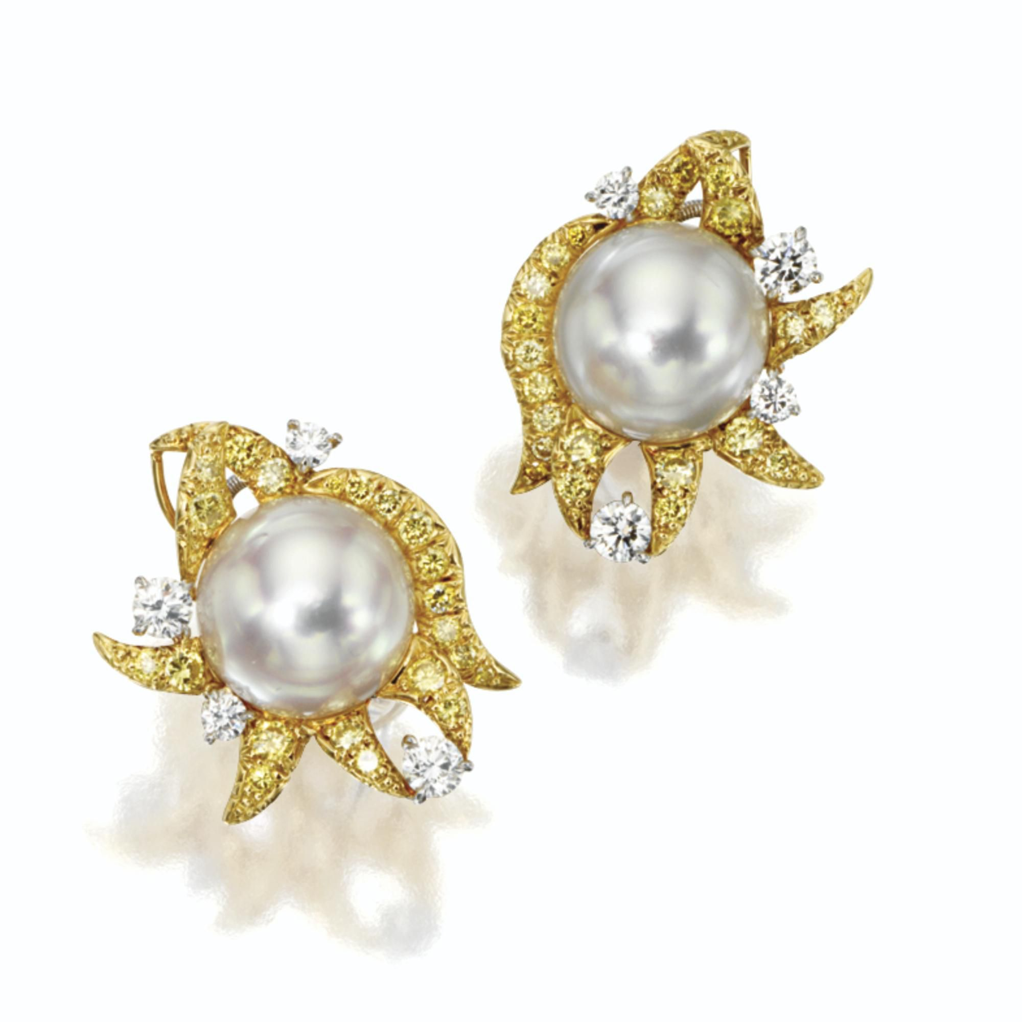 Pair of cultured pearl and diamond earclips, Donna Vock   lot   Sotheby's