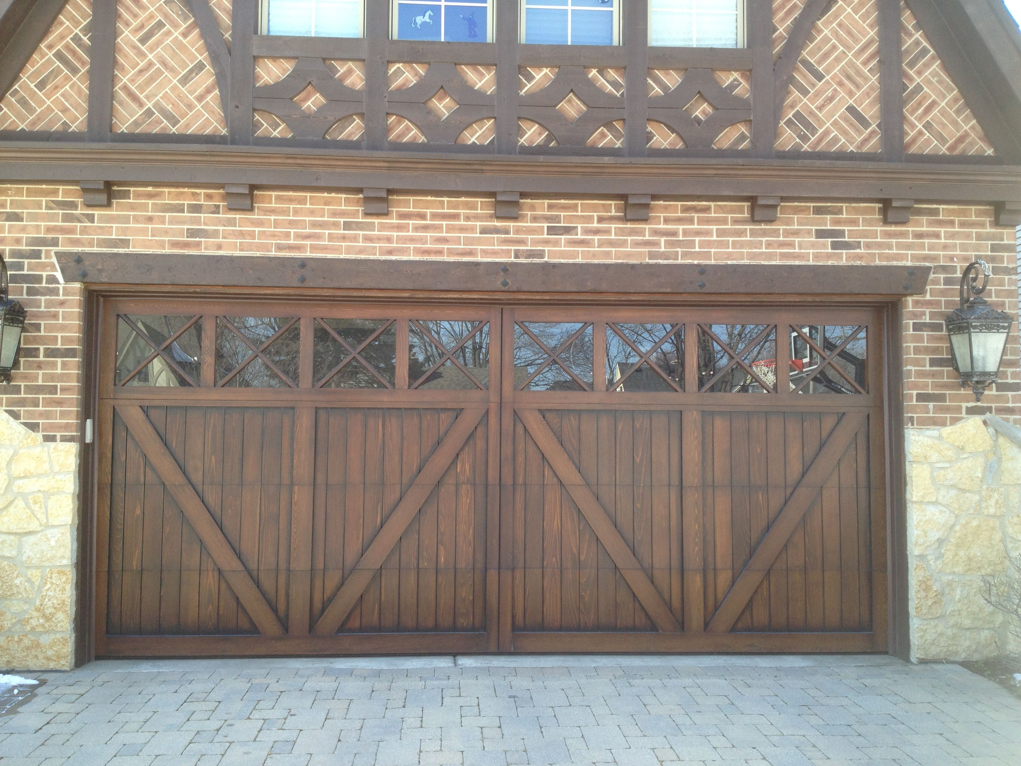 Wood Carriage House Garage Door Tudor Garage Door Www Garagedoorwebsite Com Garage Door Design Carriage Style Garage Doors Garage Door Styles