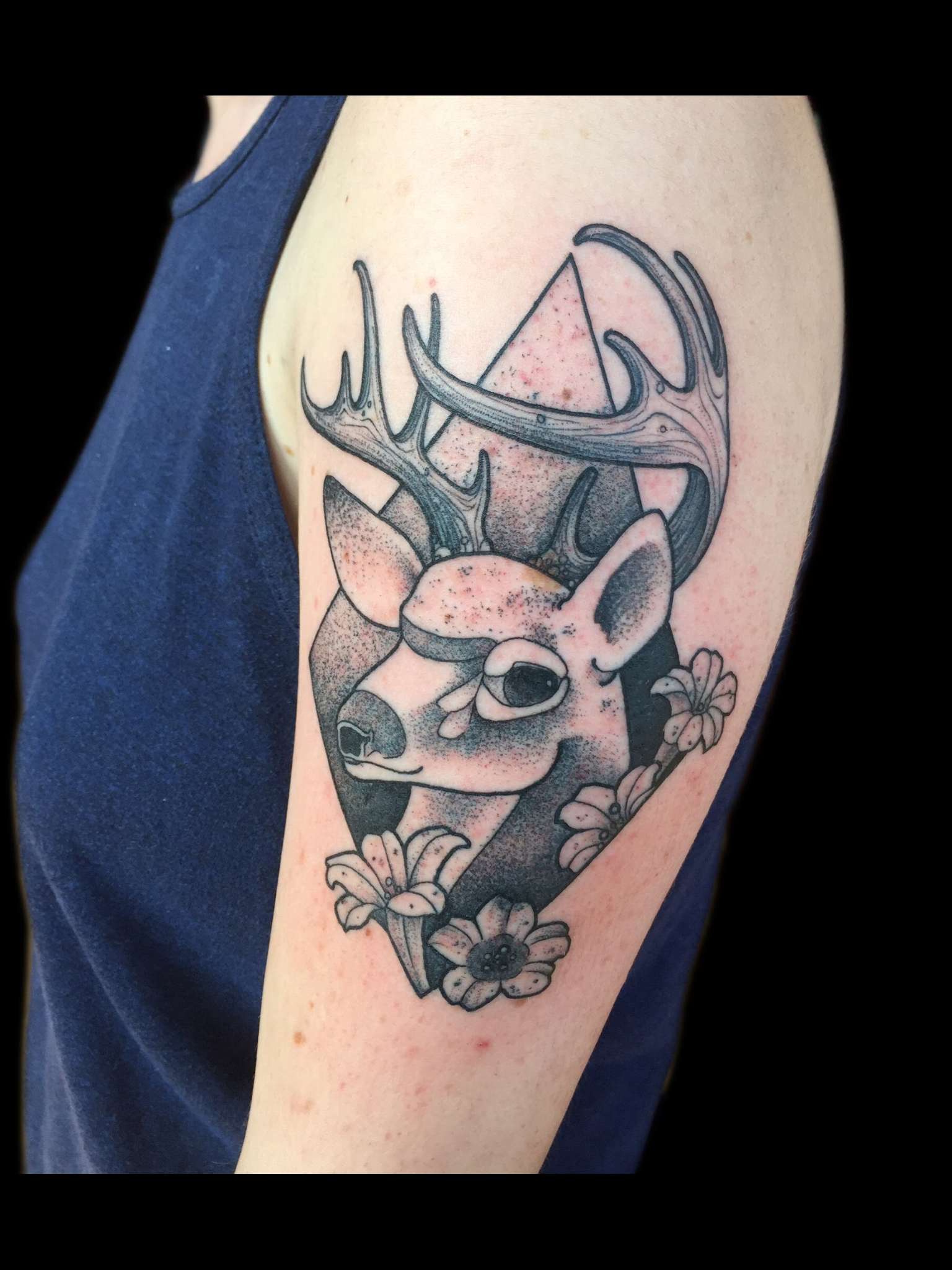 Blackwork deer head geometric tattoo by Barham Williams
