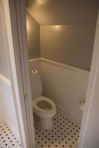 Great pocket door for the basement/laundry toilet. | Houzz Attic Bathroom | Loft Bathroom | S... #downstairsloo