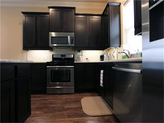 Dark Cabinets W/ Lighter Floor