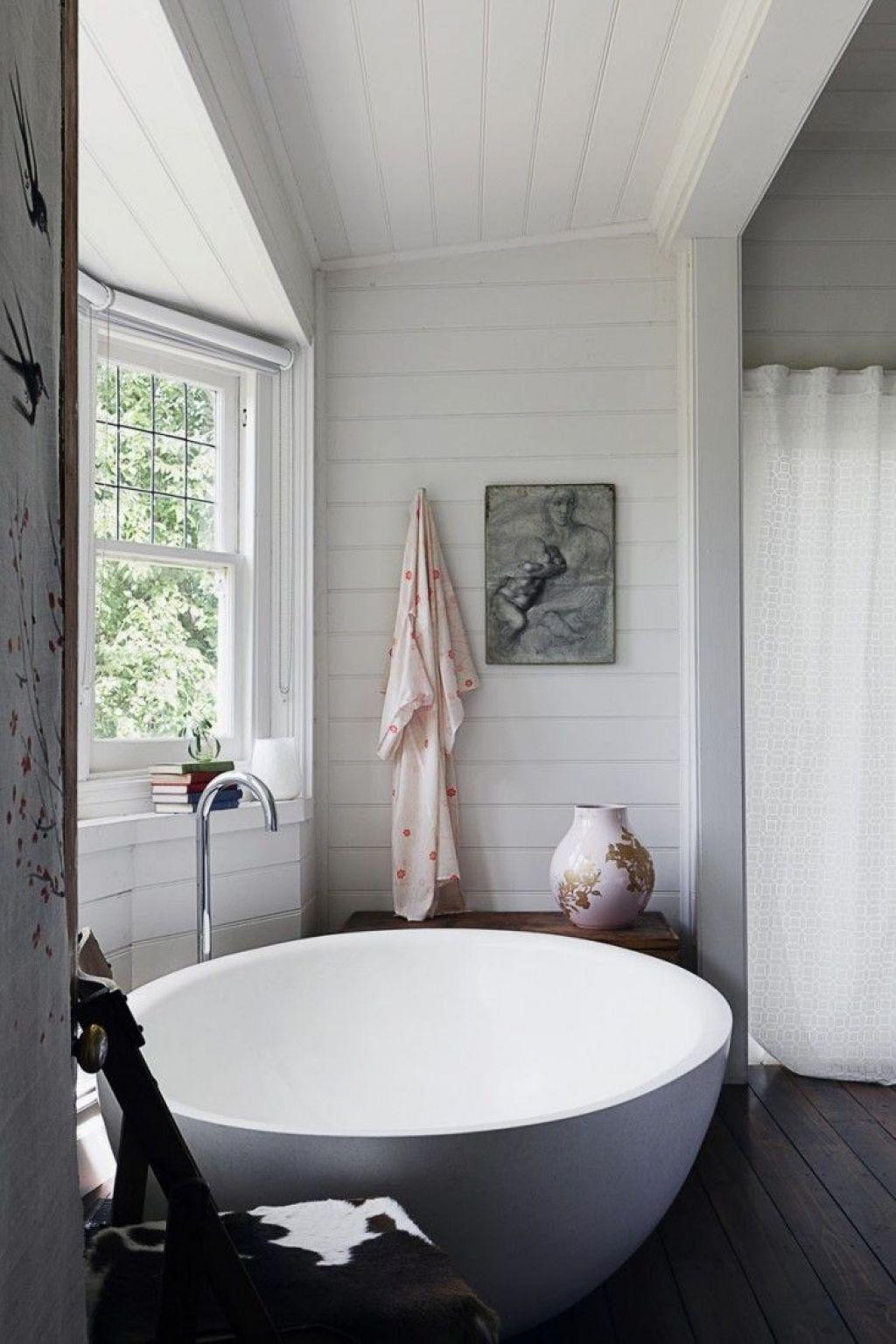 Modern cottage bathroom - Cottage Bathroom With Modern Round Bathtub