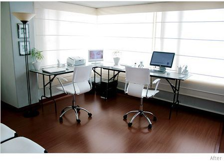 Superb An L Shaped Desk With A Few Electronic Devices And A Typical Office Chair.