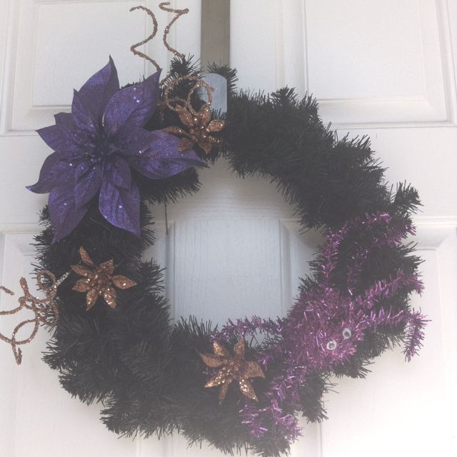 Sparkly Halloween wreath - simple black wreath with accessories from Michael's craft store.
