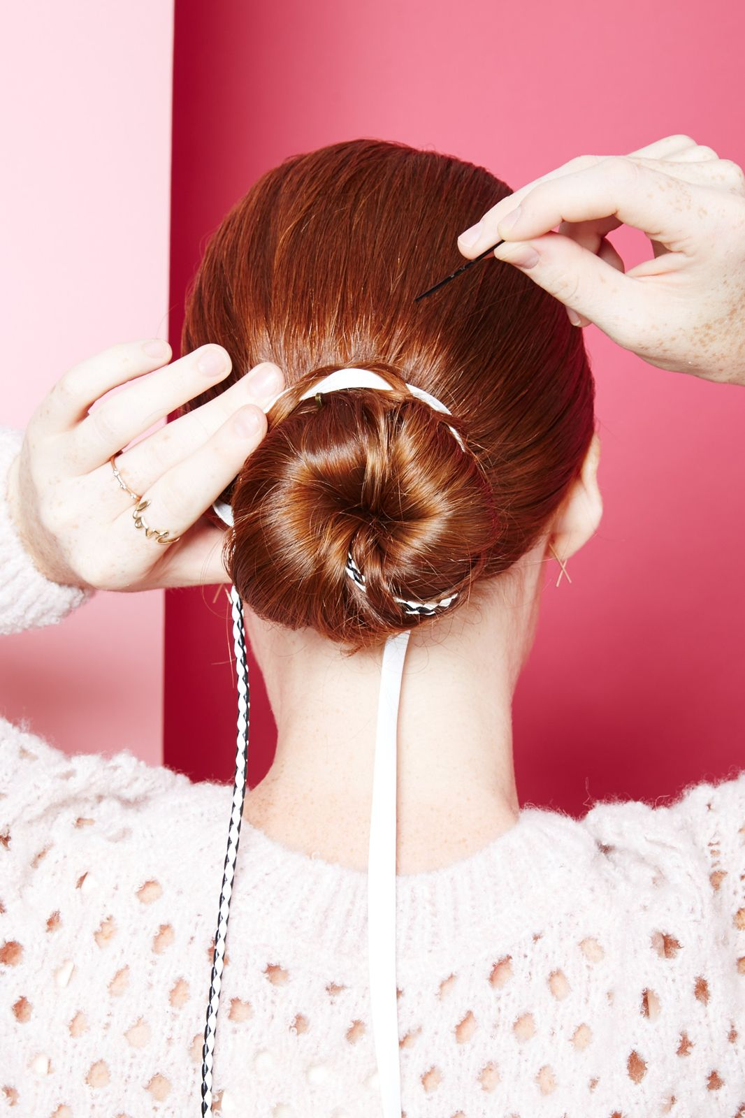 Wrap the leather braids around the bun, pinning as you go.
