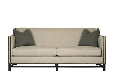 family room sofa with stretcher bottom and nail heads