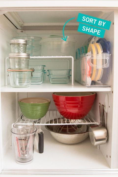 many people find food storage containers intimidating to corral but this cabinet makes it look