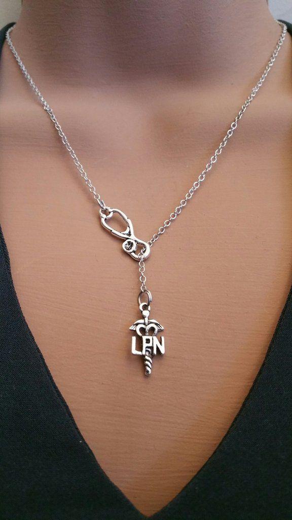 37c0265db52d6 This gorgeous necklace features an antique silver LPN nurse caduceus ...