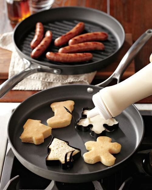 What a fun idea! Using cookie cutters to make mini, shaped pancakes!
