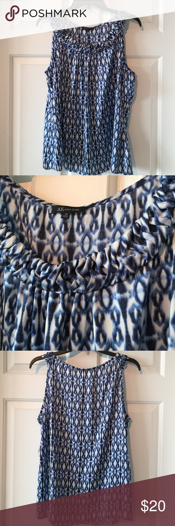 Blue and white patterned blouse size XL This lovely Anne Klein sleeveless blouse is soft and silky. Amazing braid like textured neckline. Gorgeous blue and white pattern. Size XL fits true. Anne Klein Tops Blouses