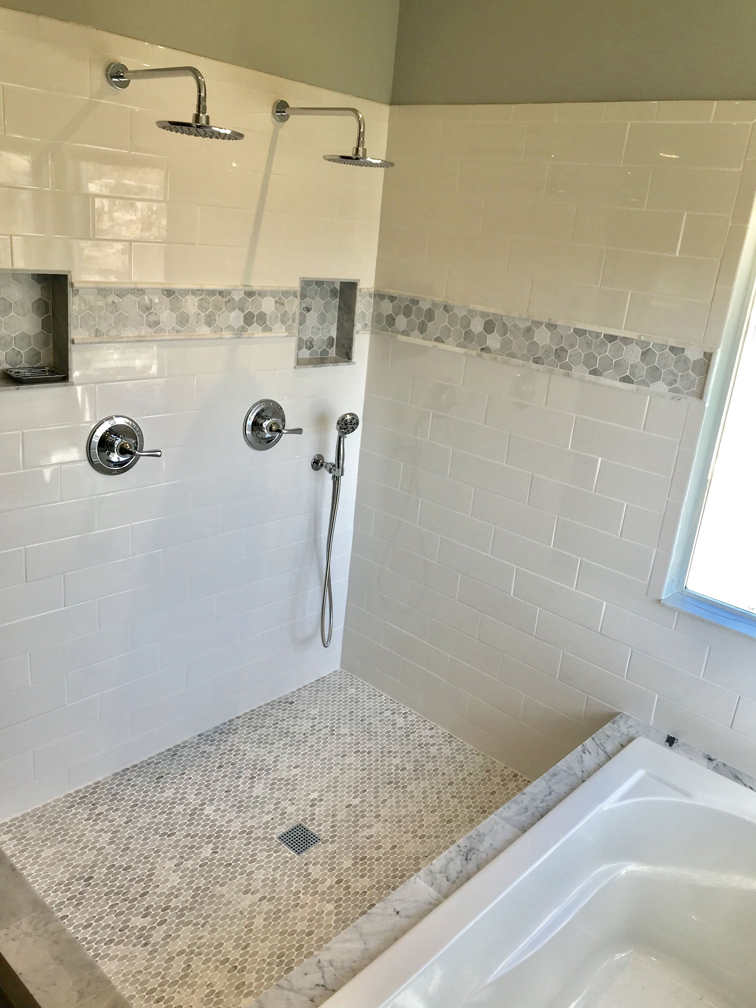 Love our new master bathroom 4x12 subway tiles marble accents dual rainfall shower heads