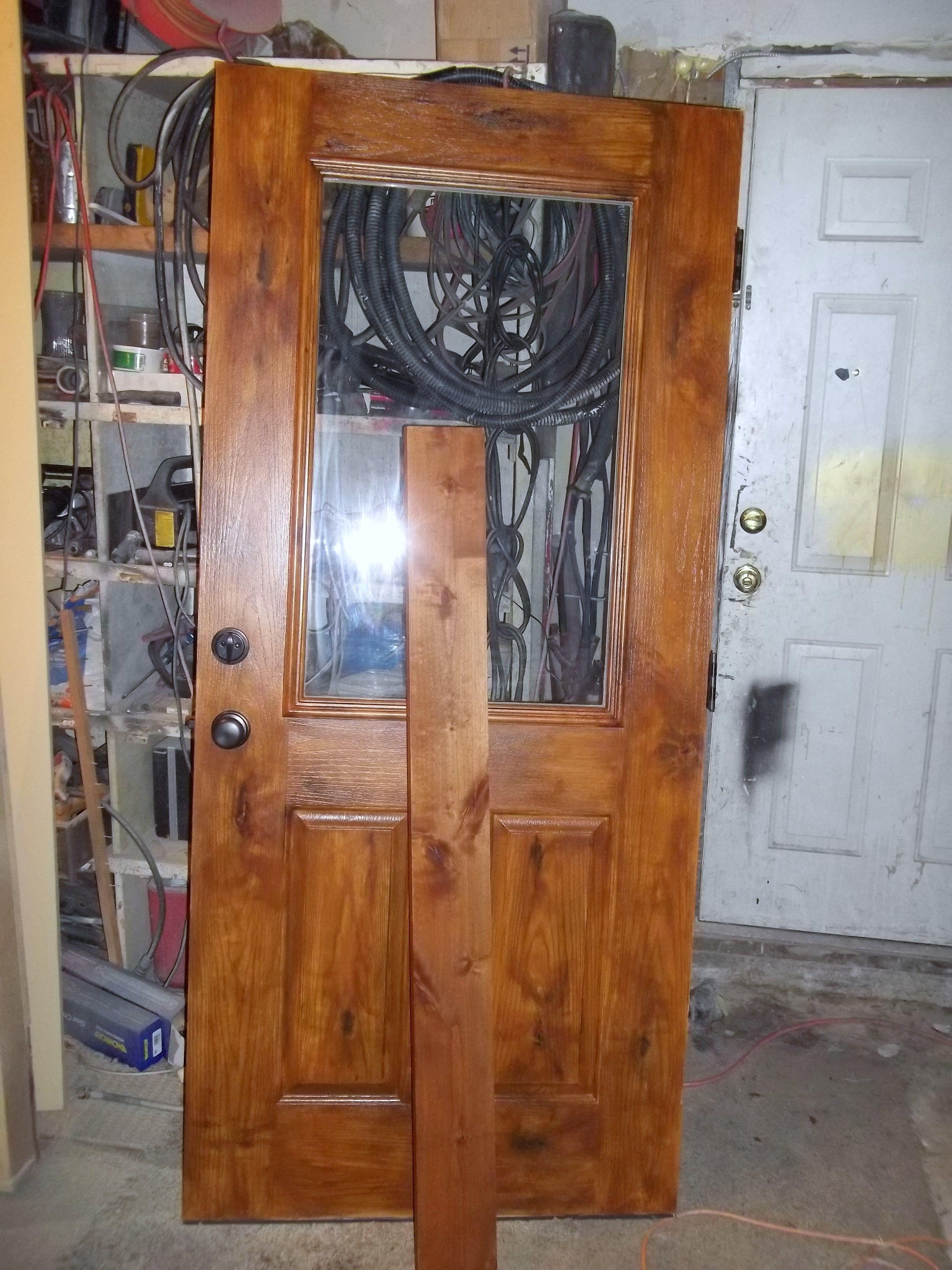 Fiberglass door painted to look like wood