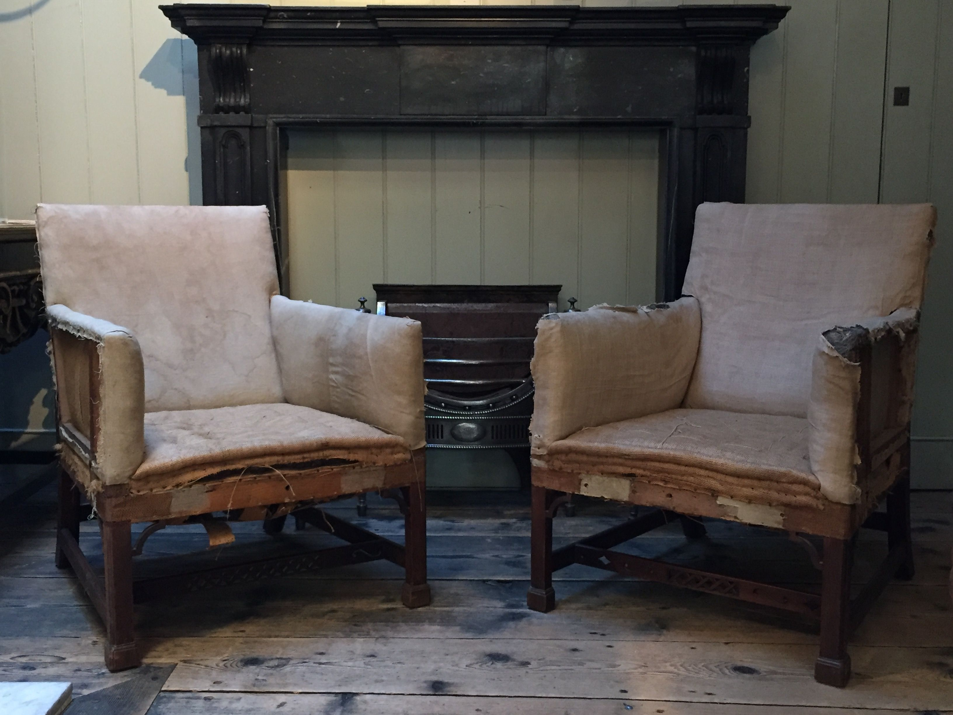 a magnificent pair of c18th carved mahogany gainsborough armchairs