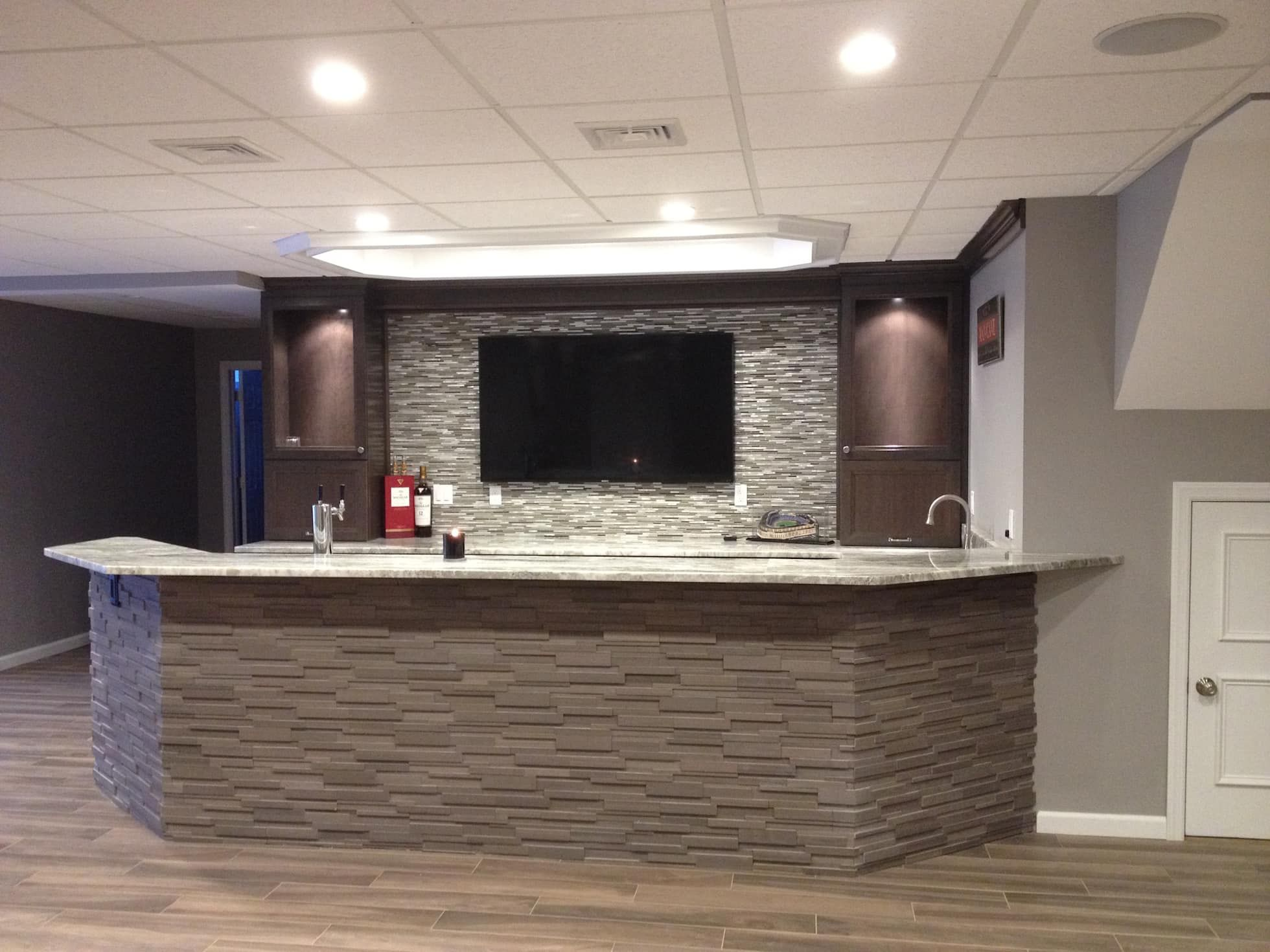 Basking Ridge Basement Bar classic Wine cellar by Kitchen Krafter Design Remodel Showroom