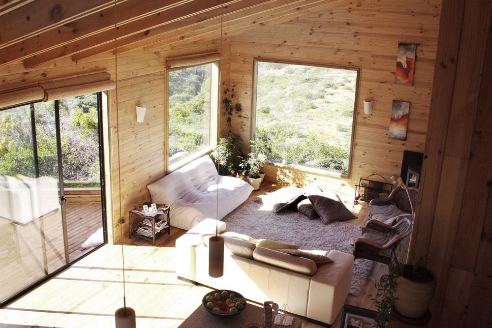 rustic-living-room-with-exotic-wooden-wall-and-cool-white-bed-sofa ...