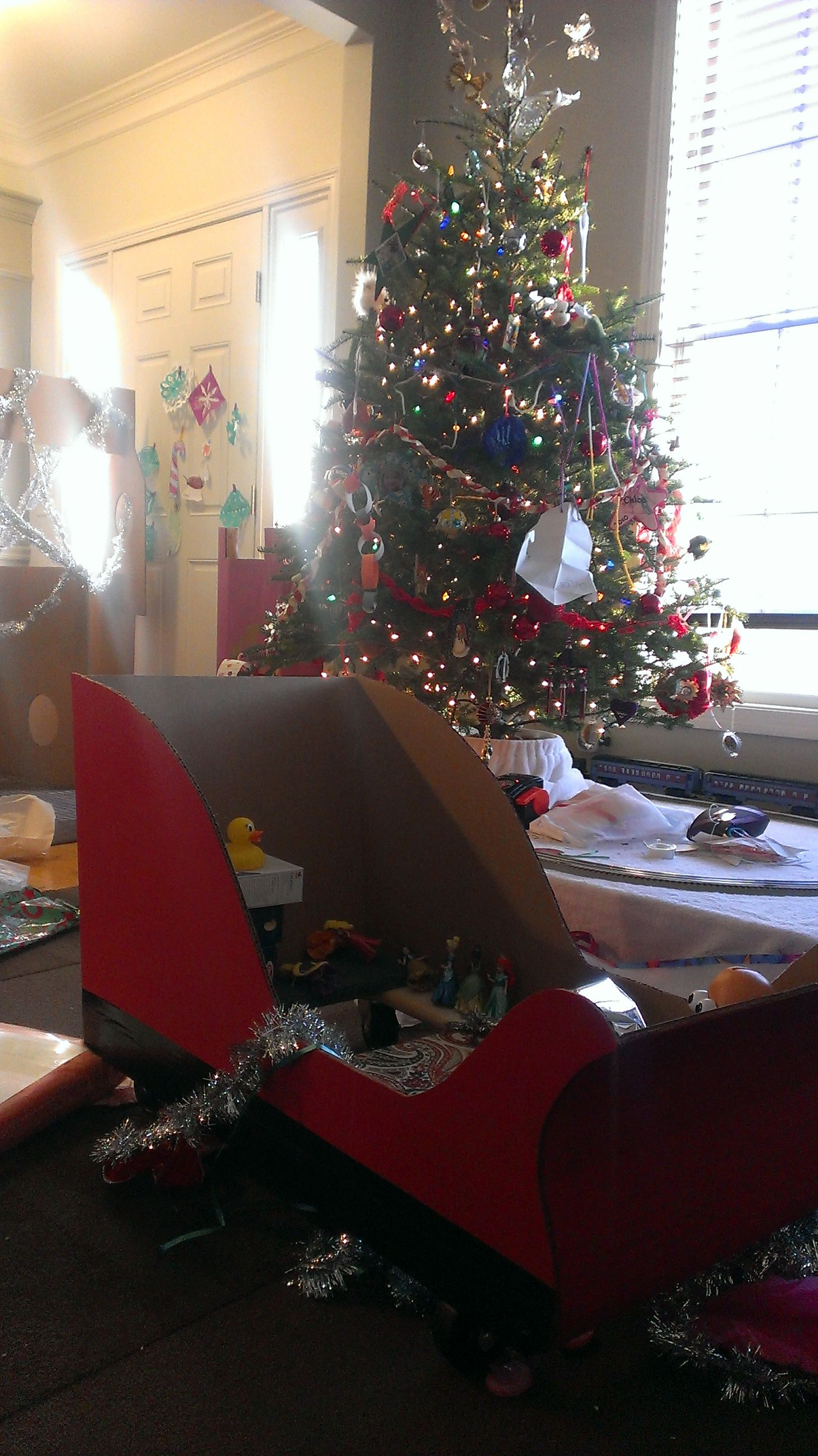 Santa s sleigh ride on toy made from cardboard and a furniture dolly