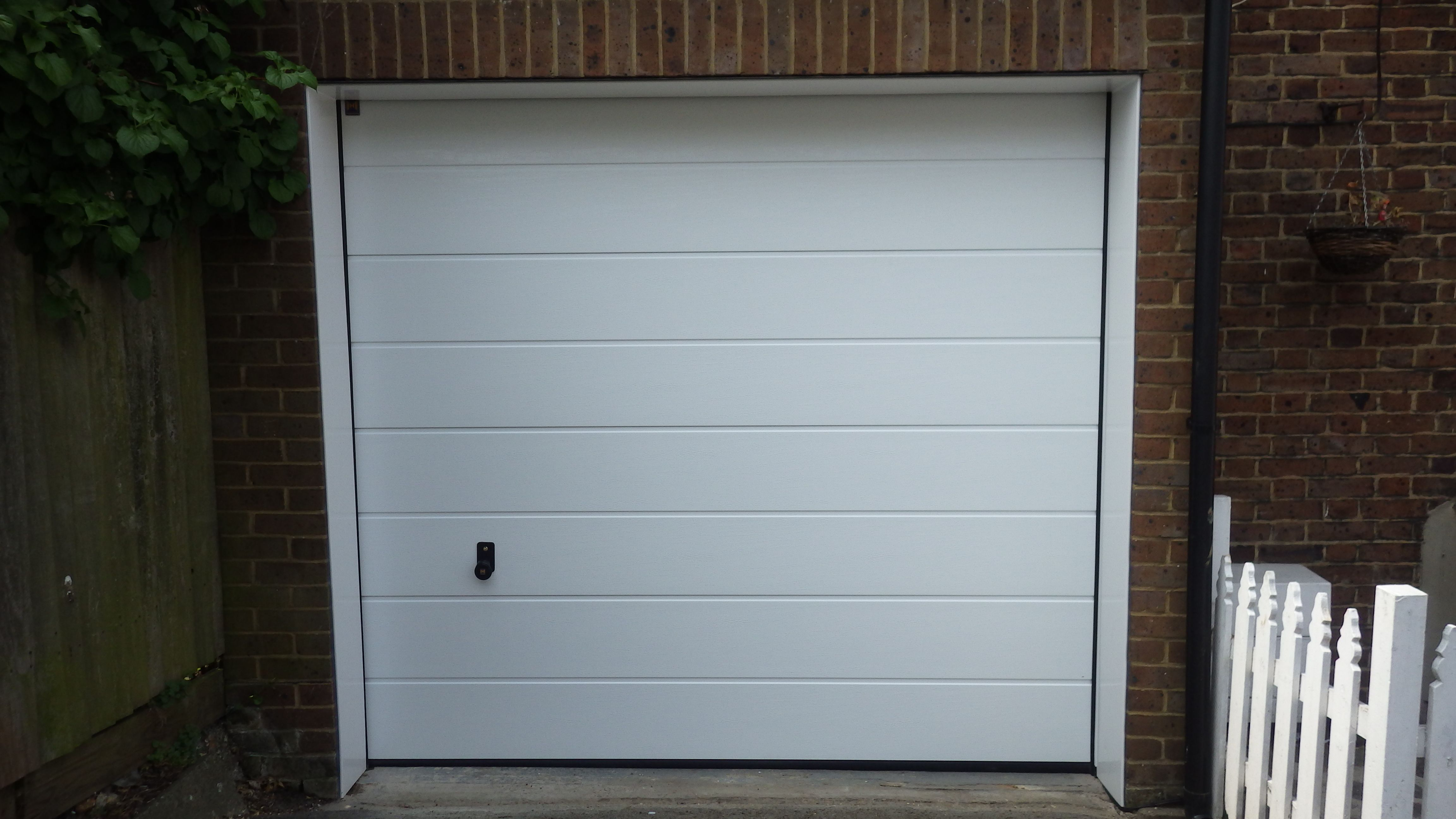 Doors and sidelights matching window on front and black onduline roof - Find This Pin And More On Hormann Sectional Garage Doors