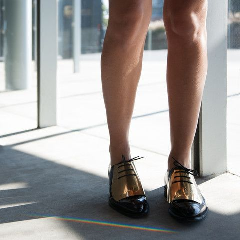 These gold and black loafers are everything.. Pose by thefashionadroit
