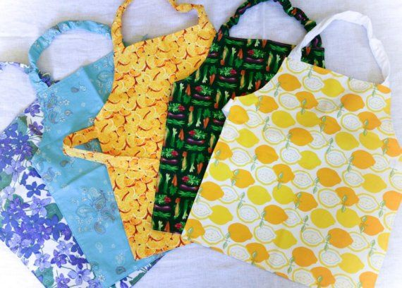 One of my favorite suppliers for aprons or three part card packet holders is from Austin, Texas: Homemade Montessori makes custom aprons - You choose color and size - for toddler and primary age children.  A Montessori guide herself, she knows whereof she sews!