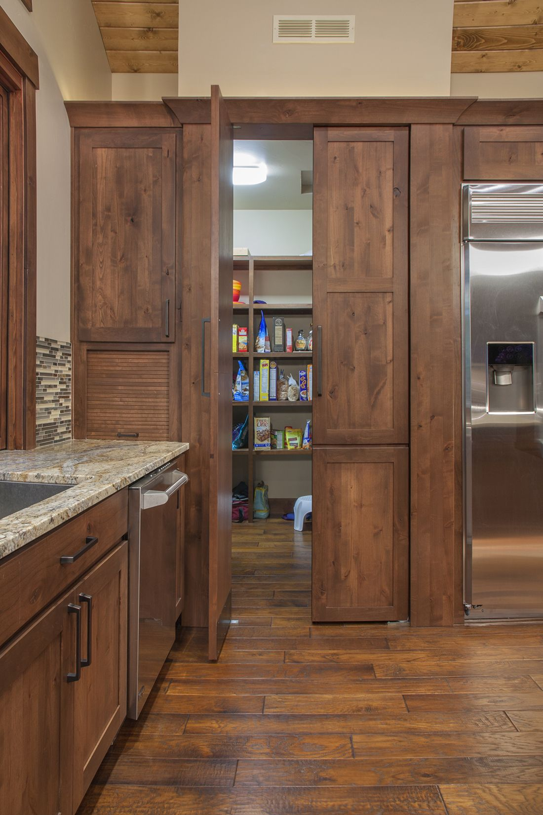 Pantry door off kitchen by Huntwood for Mort Construction ...