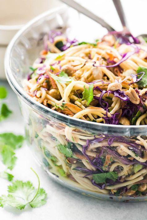 A spicy Thai spaghetti salad in a glass bowl with cilantro ...