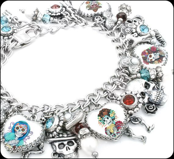 I have 3 left of this amazing day of the dead charm bracelet features over 35 gorgeous charms with colorful images, fresh water pearls, swarovski crystals and silver charms, created in 316L stainless steel. Shop Now! http://etsy.me/1OYGY8g?utm_content=bufferb59b1&utm_medium=social&utm_source=pinterest.com&utm_campaign=buffer? #blackberrydesigns #dayOfTheDead #SugarSkulls #Etsy #Handmade #SanDiego #CharmBracelet #HeartJewelry #FriedaKhalo