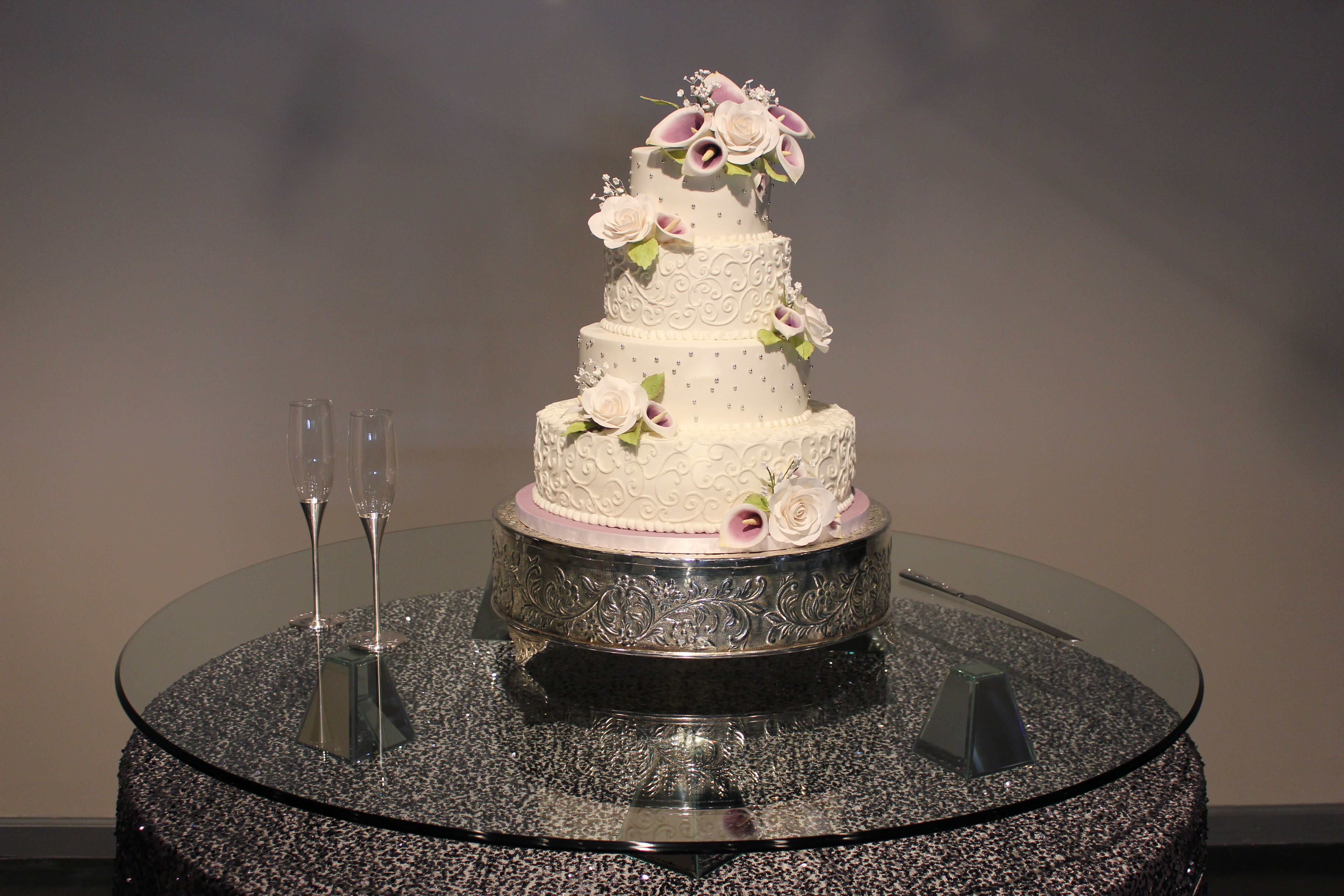 Buttercream wedding cake with swirls and silver dragees all hand