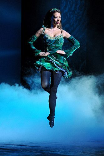 Riverdance  She's in a seductive green dress and she's dancing - she could be a baobhan sith