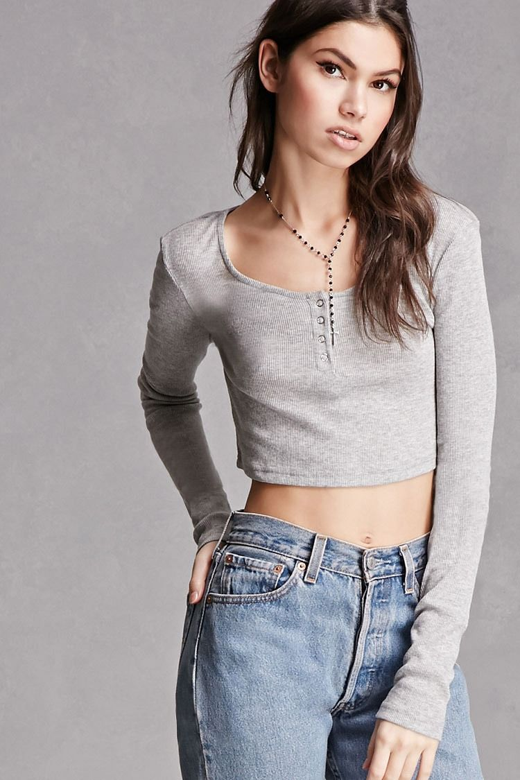 a138f7ec9ce A ribbed knit henley top featuring a crop length, snap-buttoned placket,  scoop neckline, and long sleeves. This is an independent brand and not a Forever  21 ...