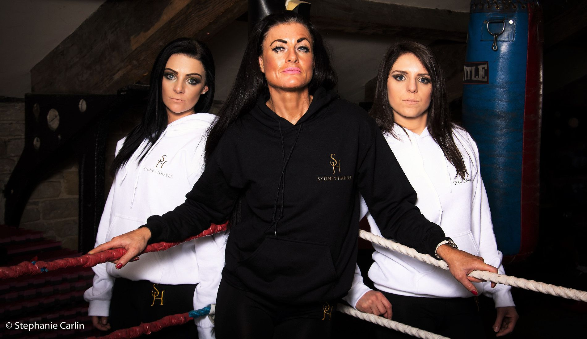 Models wear Black and White overhead hoodies.
