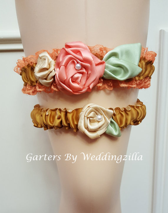 This #wedding #garter set reminds me of a flower garden in bloom. Gold  satin wedding garter set is edged in a burnt orange lace.  I hand made rolled roses in peach and champ... #bride #bridal #weddings #ido #bridalgarter #weddinggarterbelt #accessories ➡️ http://jto.li/rs6Wh