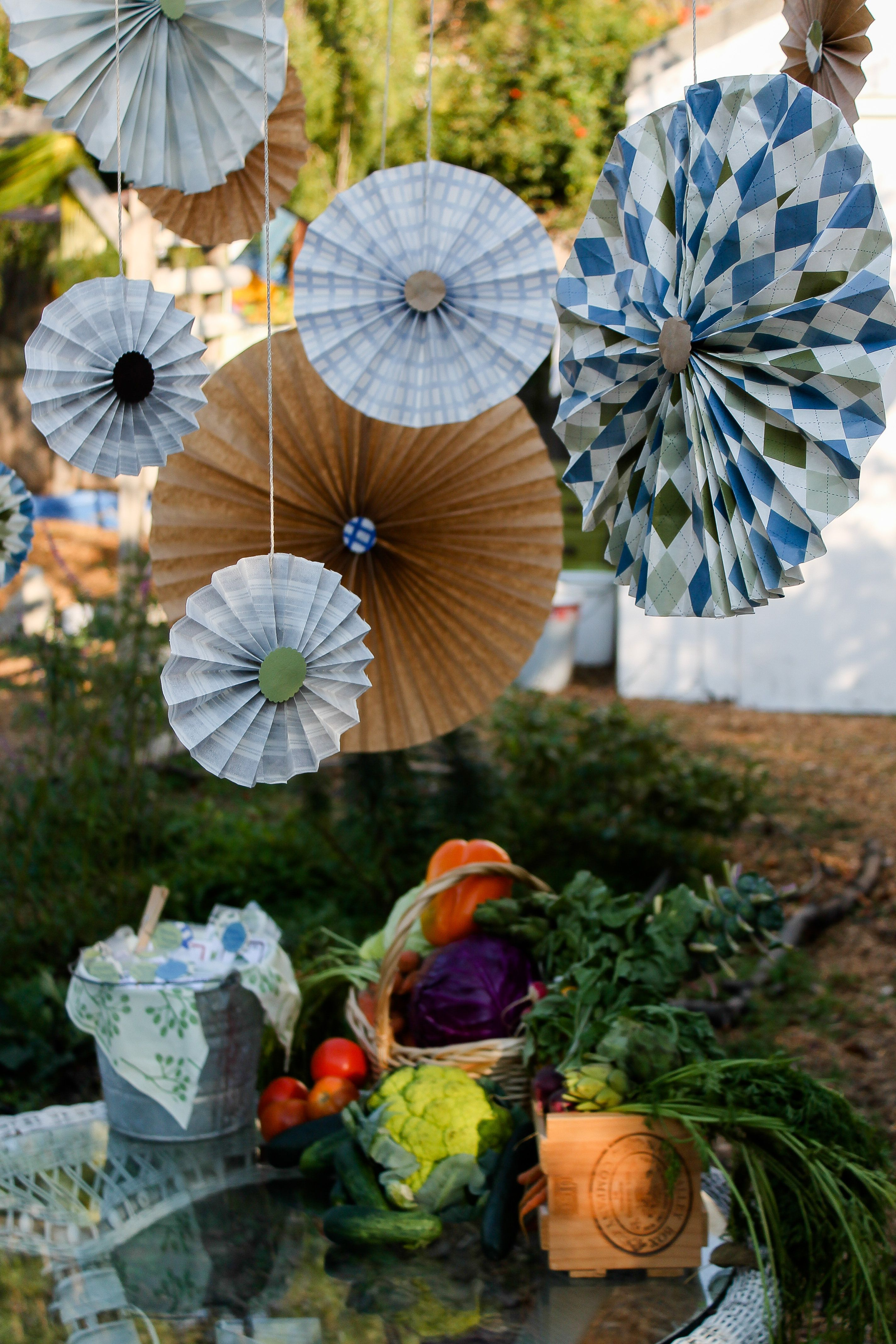 Garden decor for baby shower  DIY colorful accordion paper flowers Boy baby shower peter rabbit