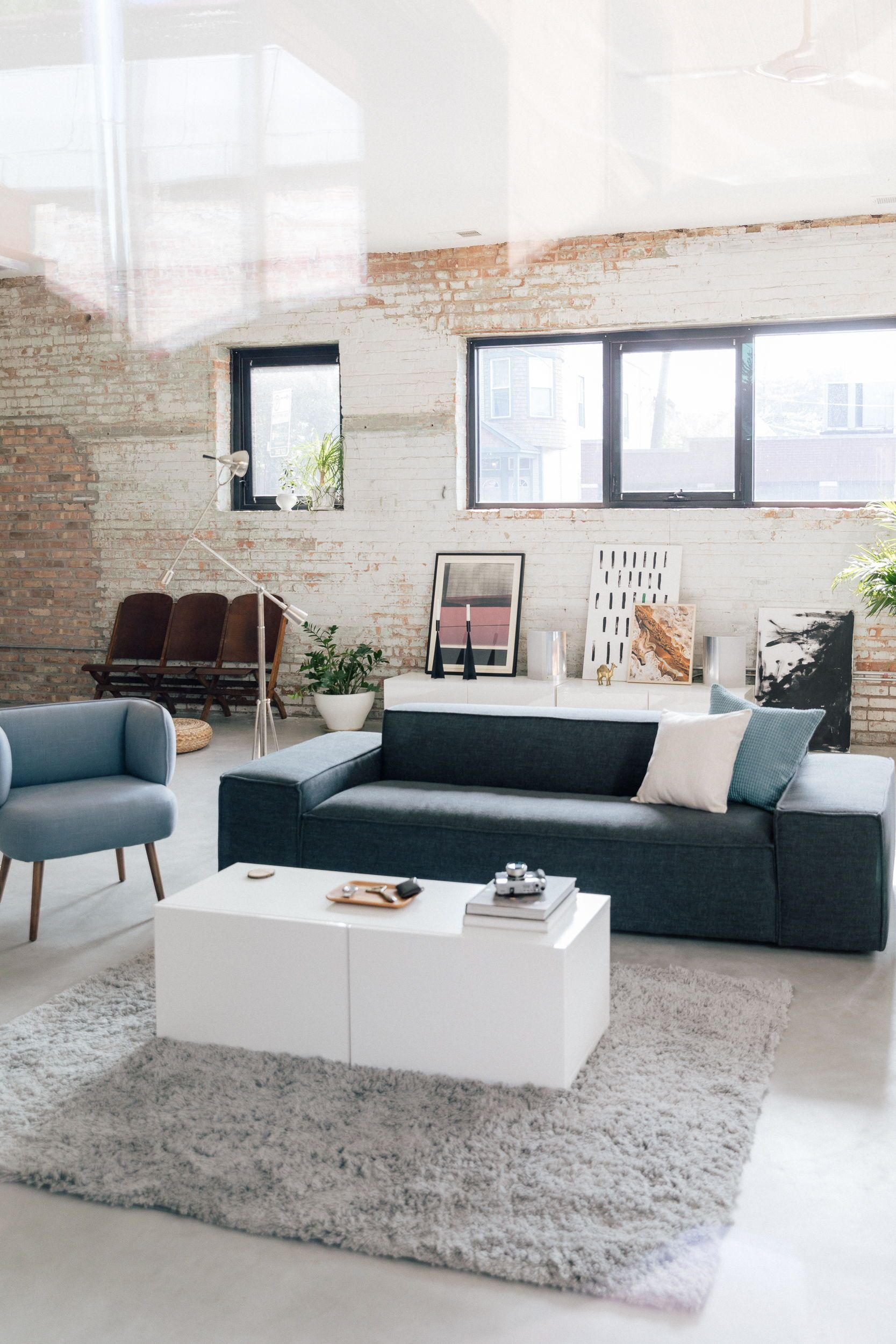 This Living Room Features Two Pieces Of Custom Furniture Interior Define S Parker Slip Grey Furniture Living Room Rugs In Living Room Living Room Decor Pieces