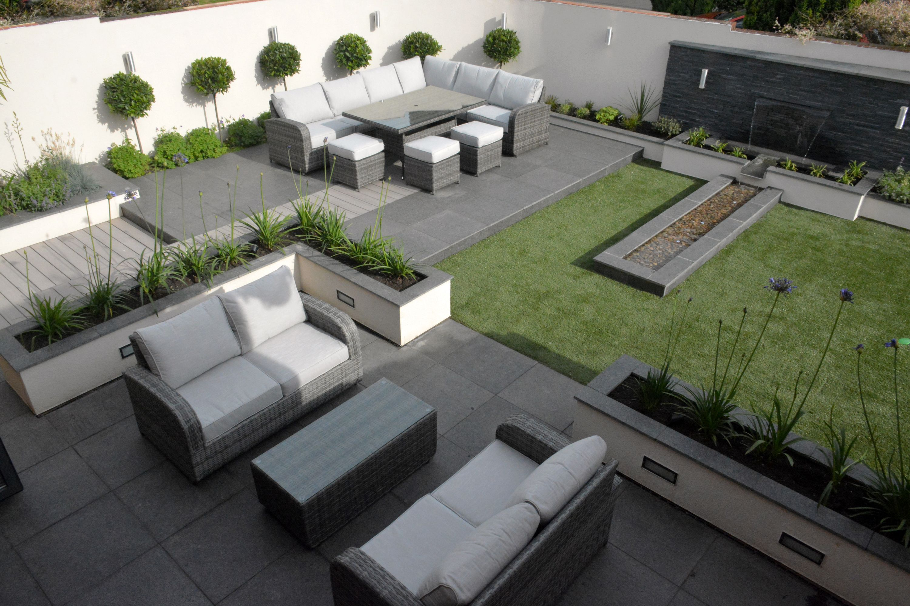 Contemporary garden with Granite paving and composite decking