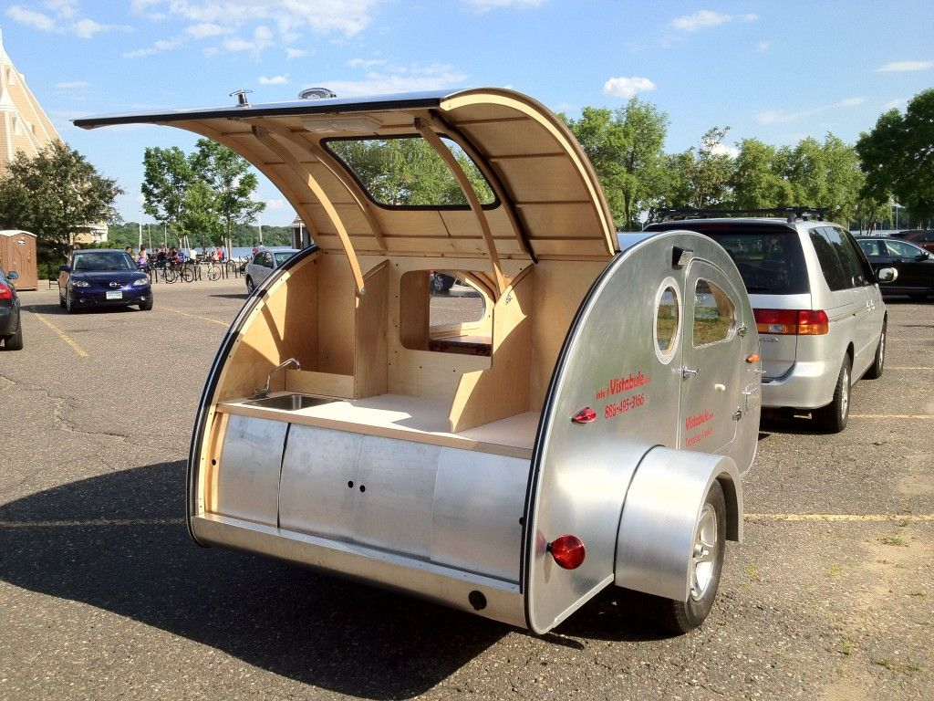 simple modern teardrop trailer with lots of windows a sink and