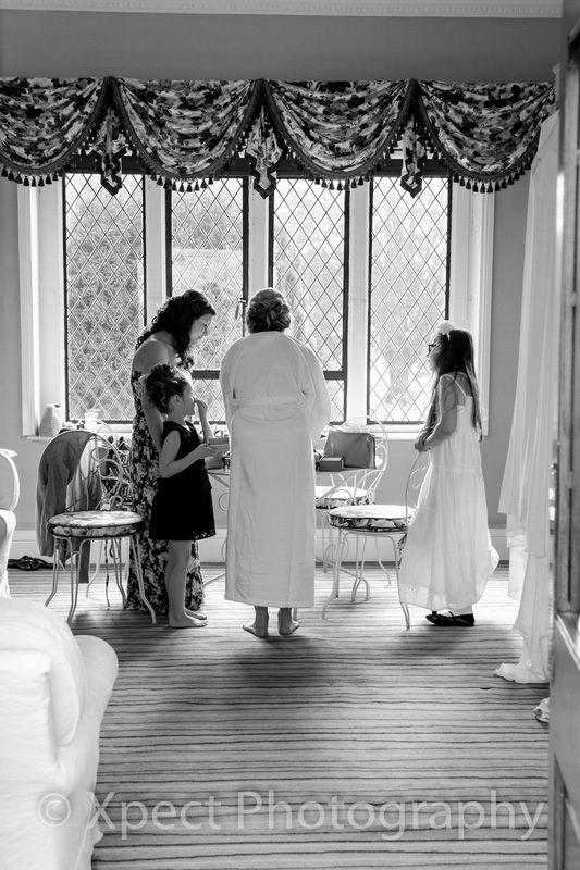 Miskin Manor Weddings, black and white photograph of wedding preparations.