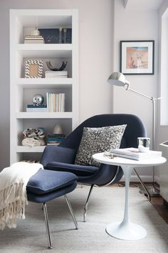 Sophisticated reading nook that's casual, family friendly, and saves space. Love all the elements.