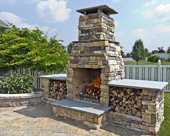 fireplace in cast veneer stone ledgestone with storage spaces for