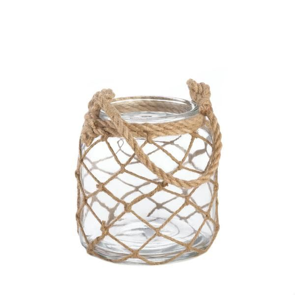 Say 'ahoy' to great style with this small nautical lighting accent. A glass lantern is wrapped with fisherman net and wrapped with a rope handle at top. Fill wi