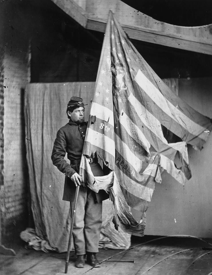 Pictured Here Is A Soldier Holding Up The Torn Flag Of The 8th Pennsylvania Reserve Colour Guard During The American Civi American Civil War Civil War War Flag