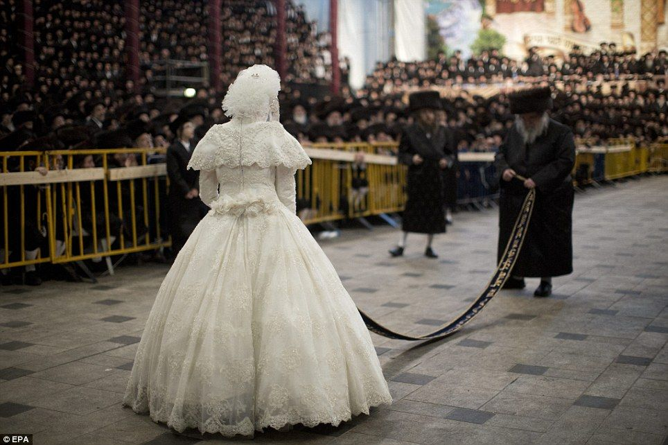 The bride with 25,000 guests: Holding a sash, newlywed, 19, waits ...