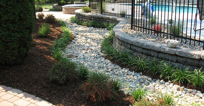 retaining wall and landscape around pool | pool ideas | pinterest