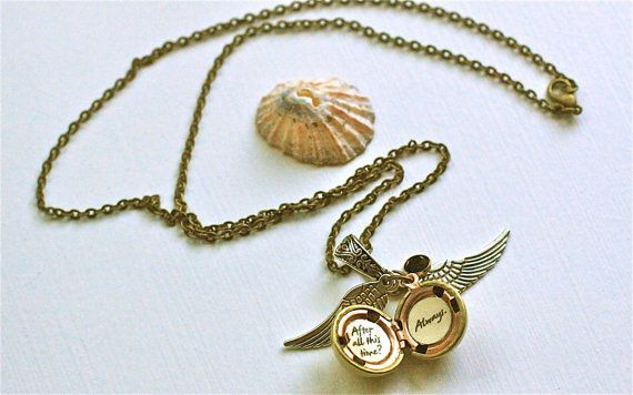 Snitch necklace with a hidden quote on inside.