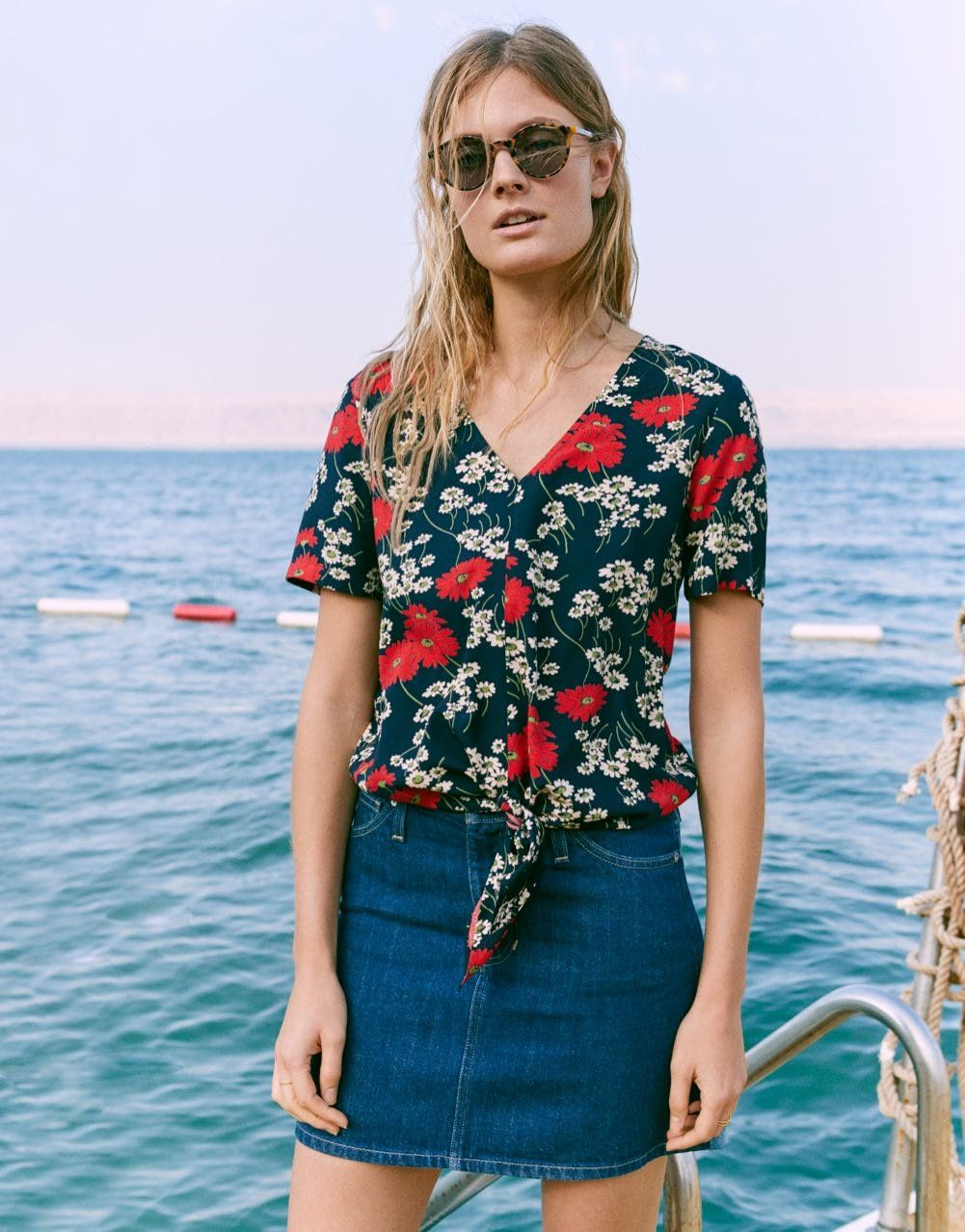 946fc8271d06c madewell novel tie-front top worn with rigid denim postage stamp skirt +  layton sunglasses.