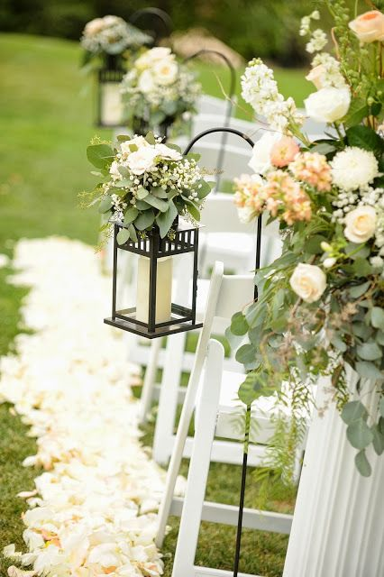 Lanterns With Greenery And Flowers Along The Aisle Wedding