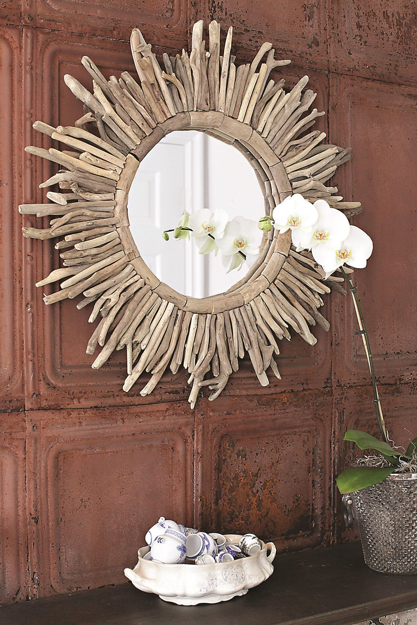 DETAILS Create an eye-catching focal point in your living room or master suite with this stylish round wall mirror, showcasing a sunburst-inspired design. Pr