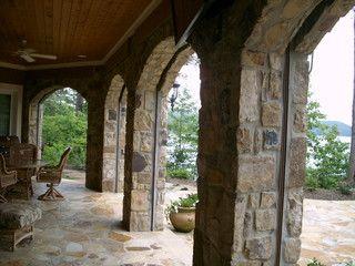 phantom retractable screens in stone archway house design