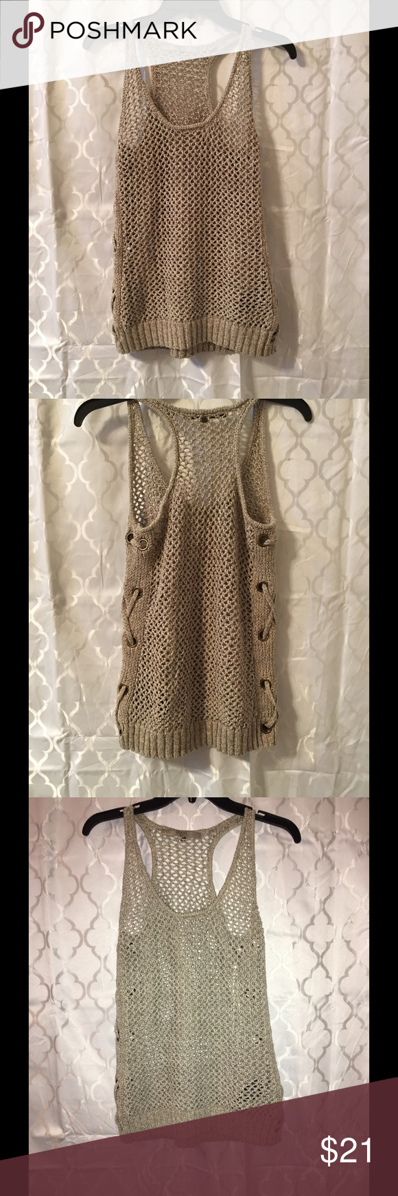 Guess Tank Sweater Guess Olive/Tan/Oatmeal color tank sweater. Perforated look for layering. Lace up side detail with gold hardware. Worn once. Last photo is with flash on. Size XS Guess Tops Tank Tops