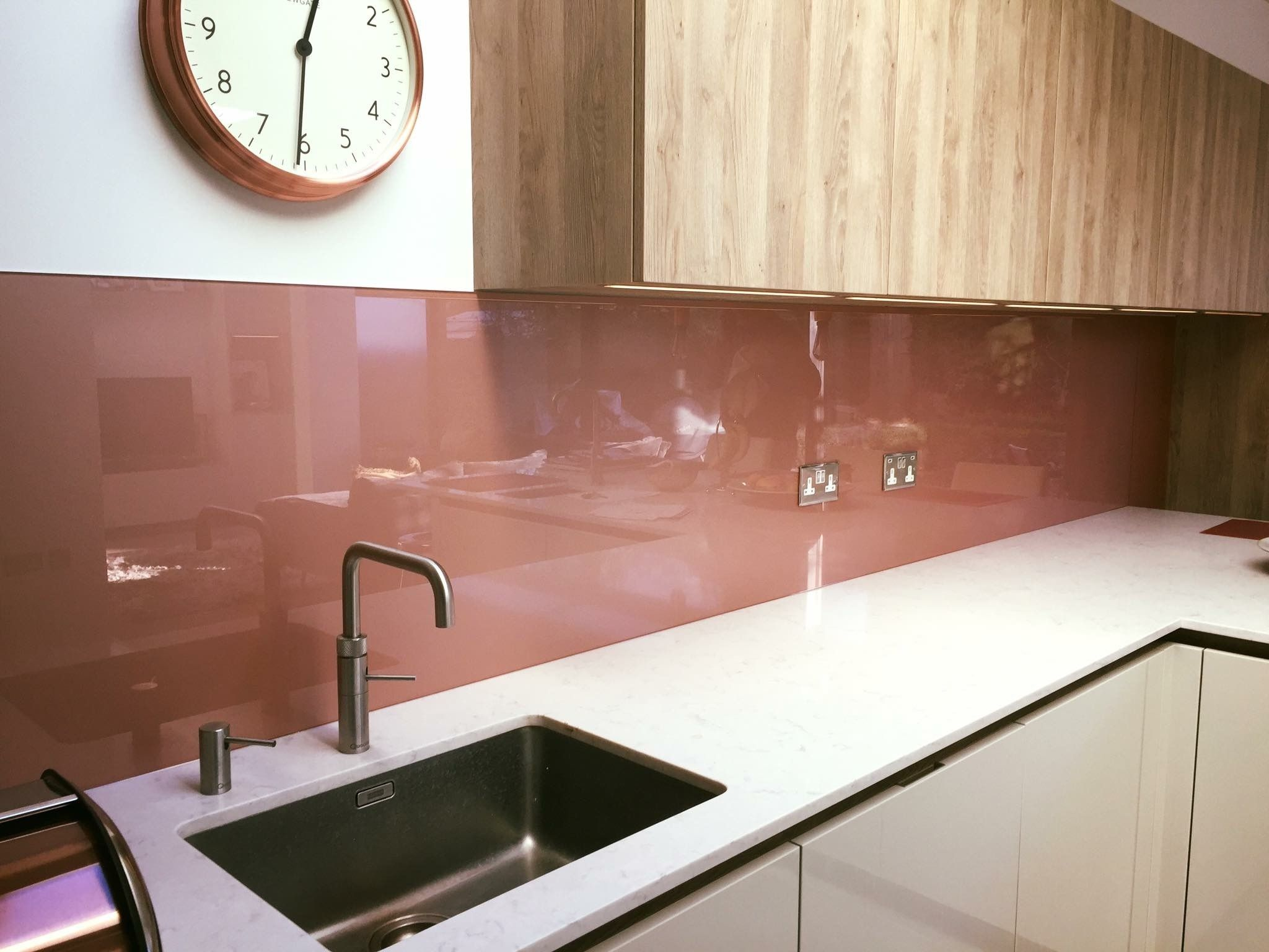 Lovely contemporary copper coloured painted glass kitchen splashback