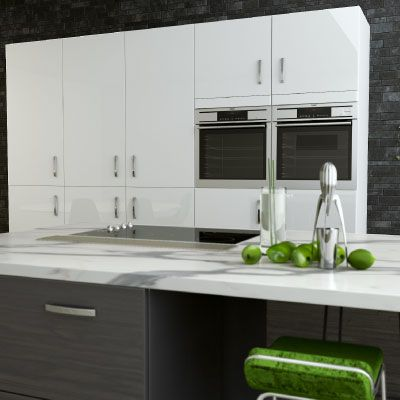 Dark Kitchen Units With A Contrasting White Marble Counter Top. Simply  Kitchens Plymouth